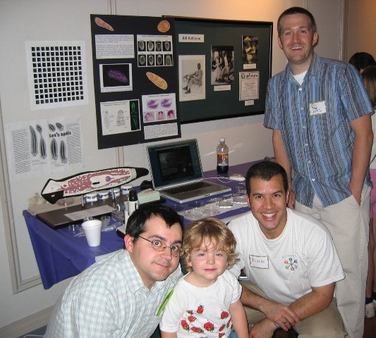 People Posing at a booth at Brain Awareness Day 2004